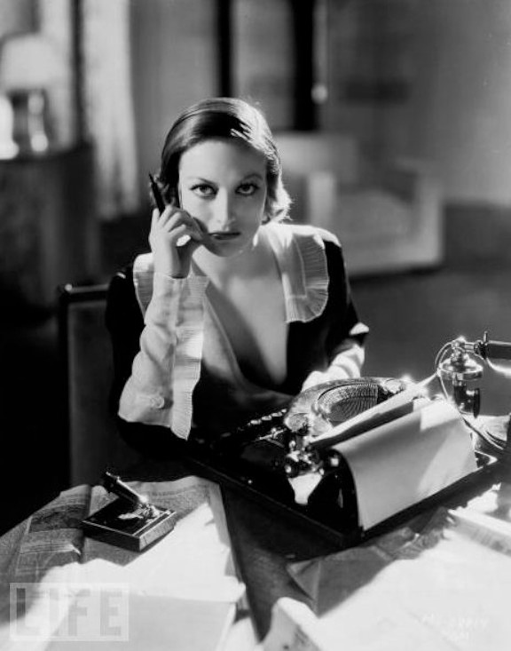 Joan Crawford, with glam typewriter.